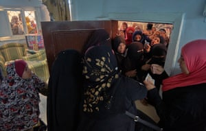Women crowd the entranceway to a charity in south Cairo on 26 April. In pre-corona Egypt, 60% of the population was already either poor or vulnerable.