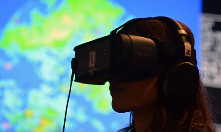COP23 Climate Change Conference<br>epa06311729 A woman wears a Virtual Reality (VR) glasses at the pavillon of Fiji at 'Bonn Zone' during UN Climate Change Conference COP23, in Bonn, Germany, 06 November 2017. The 23rd session of the United Nations Framework Convention on Climate Change Conference (UNFCCC), the 2017 UN Climate Change Conference COP23 will take place from 06 to 17 November in Bonn, the seat of the Climate Change Secretariat, under the presidency of Fiji. EPA/PHILIPP GUELLAND