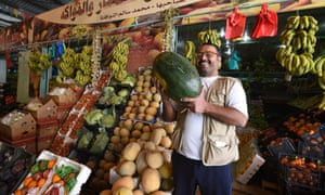 Rock the casbah: shopping for fruit in the local market.