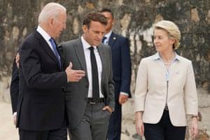 Joe Biden, president of the US, is seen with Macron and Von der Leyen walk along the boardwalk at the G7 summit