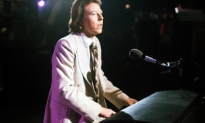 Peter Skellern standing playing a piano, 1975