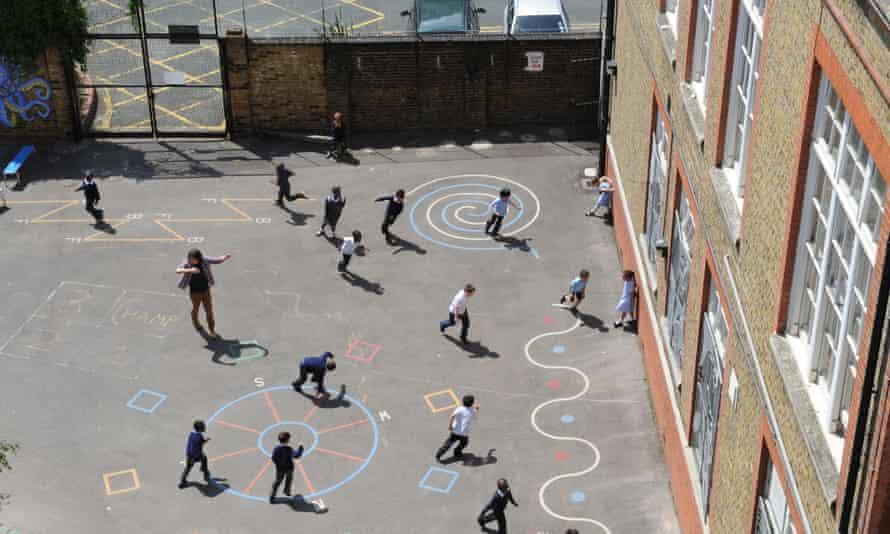 Schoolchildren playing in a school playground.
