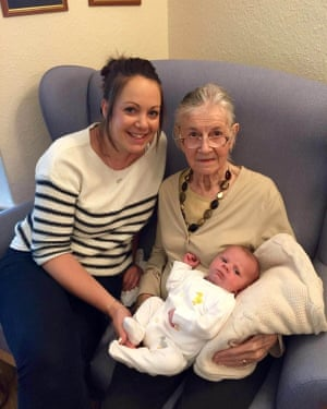 """Peggy Grainger, holding Noah, with her granddaughter Laura Sutton. See SWNS story SWCAletter; An emotional video shows the moment an """"amazing"""" grandma was read a final 'goodbye' letter from her granddaughter just days before she died from suspected Covid-19. Gemma Gunter, 37, penned the note to Peggy Grainger, 86, back at the start of April, after finding out her grandma was showing Covid-19 symptoms. And when Peggy took a turn for the worse on April 11, her carer, Laura Dunn-Green, read out Gemma's letter to her - with another carer filming it, to send to Peggy's family. The emotional farewell letter, which made Laura well up as she read it, said: """"I am so extremely proud to call you my grandma."""