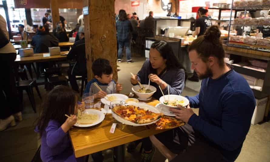 Family eating ramen and pizza at Pine Steet Market