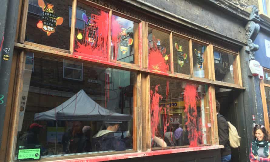 Paint still visible on the Cereal Killer cafe today, after last night's anti-gentrification protests in Brick Lane, London.