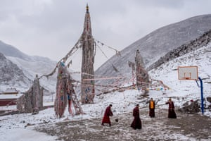 The Plateau, Tibet by Luc ForsythBuddhist monks play basketball on a court in their mountainside monastery in Zado, Tibet. Despite the light covering of snow, the monks report increasingly warmer winter temperatures each year and a reduction in quantities of fresh water on the Tibetan plateau.
