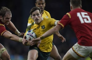 Alun Wyn Jones can't keep hold of Australia's fly half Bernard Foley as he tries to pass Wales' full-back Gareth Anscombe.