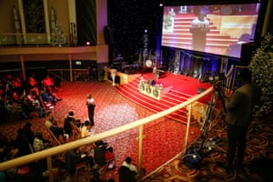 A television cameraman films Pastor Andrew Adeleke as he addresses the congregation during the 'Super Sunday' service..