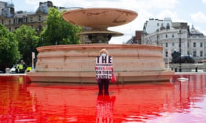 Animal rights group turns fountains red in London's Trafalgar Square