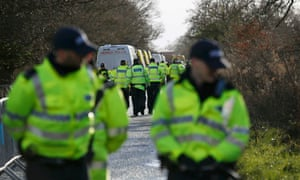 Police arrive to begin the eviction of anti-fracking protesters from an IGas test drilling site near Upton