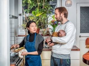 Shuko Oda and her husband Nick Hutchinson with their newborn son