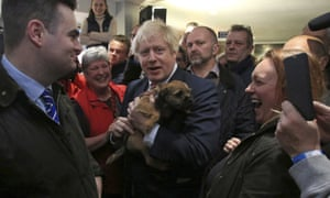Boris Johnson holds a supporter's dog on a visit to Sedgefield.