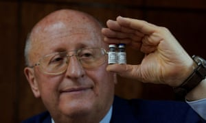 Alexander Gintsburg, director of the Gamaleya National Research Center for Epidemiology and Microbiology, shows bottles with Sputnik-V vaccine