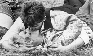 Hippies making out on grass summer of love 1967
