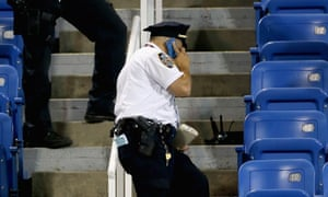 Police stand guard over drone after it crashed into stands in Louis Armstrong stadium.