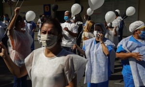 About 50 essential health professionals stopped their activities to protest with balloons in front of the University Hospital of Sao Paulo. The protesters, in addition to holding black and white balloons, wore vests with black crosses and walked around the hospital. Protest On International Nursing Day In Sao Paolo, 12 May 2020.