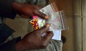 Man holding TB medication