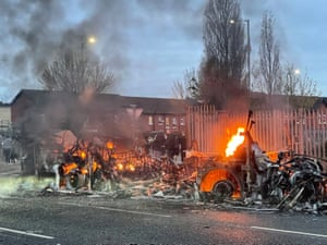 The wreckage of a Translink Metrobus that was set on fire on the Shankill Road in Belfast during rioting last night.