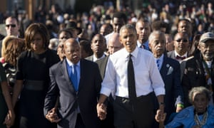 Barack Obama walks alongside Lewis across the Edmund Pettus Bridge in 2015 to mark the 50th anniversary of the Selma to Montgomery marches in Selma, Alabama.