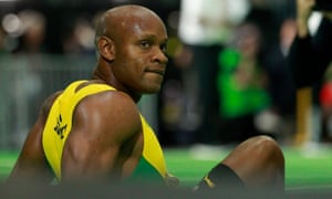Asafa Powell looks dejected after his race