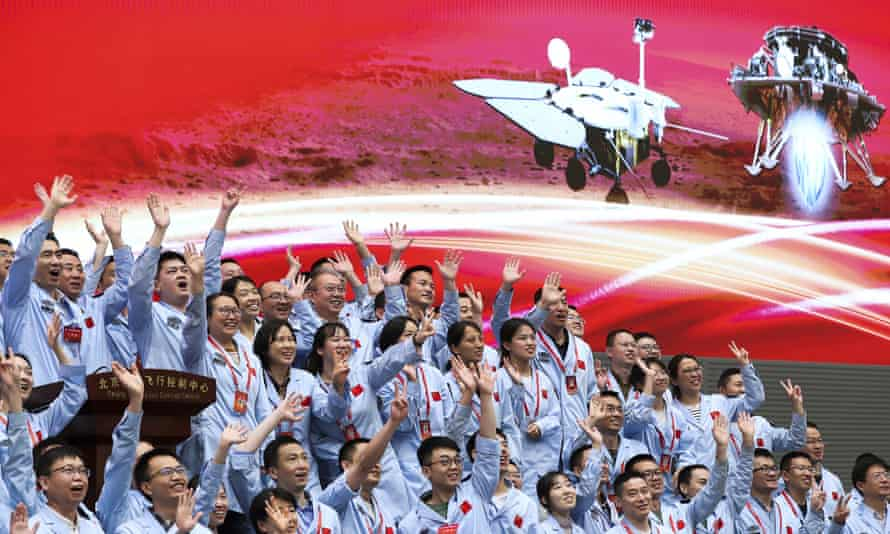 In this photo released by Xinhua News Agency, members at the Beijing Aerospace Control Center celebrate after China's Tianwen-1 probe successfully landing on Mars.  - 5000 - China lands unmanned spacecraft on Mars for first time | Space