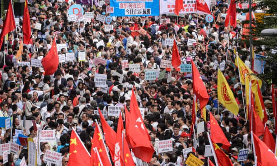 Pro-Beijing supporters gather outside the Legislative Council in Hong Kong.