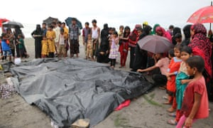 People gather around the dead bodies of Rohingya children who had died after their boat capsized off Teknaf, Bangladesh.