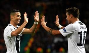 Paulo Dybala celebrates with Ronaldo after scoring.