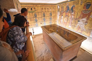 Luxor, Egypt A group of tourists look at the golden sarcophagus of the 18th dynasty Pharaoh Tutankhamun, displayed in his burial chamber in the Valley of the Kings on the west bank of the Nile river. The famous tomb underwent a nine-year conservation by a team of international specialists