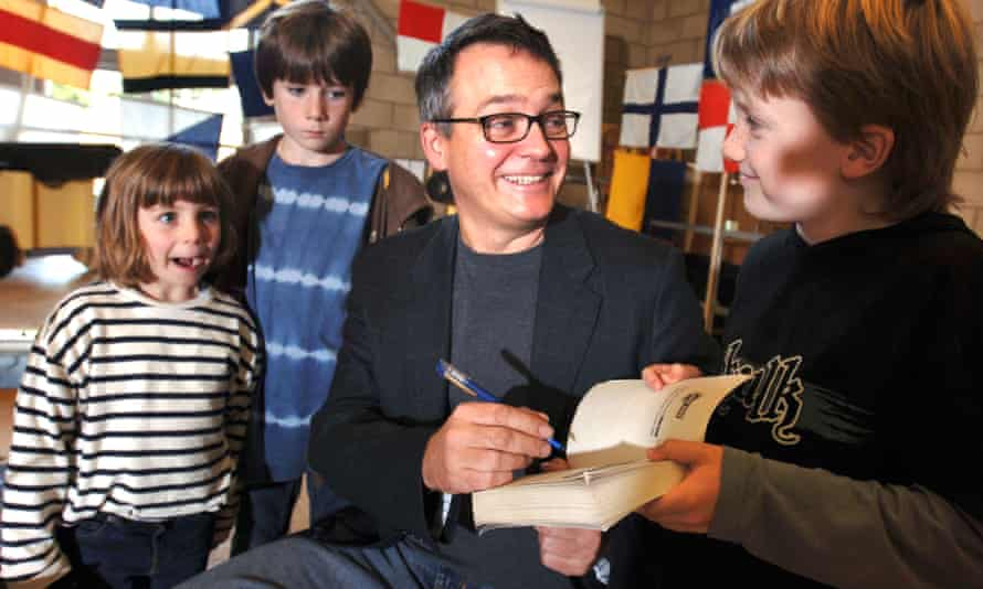 Charlie Higson signs a Young Bond book.