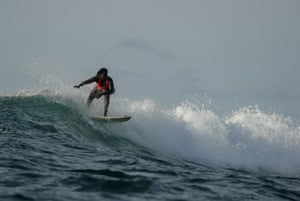 Khadjou surfs during a training session off the coast of Ngor