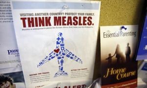 A poster warning of the dangers of travelling without a measles vaccination