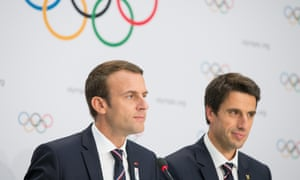 President Emmanuel Macron, left, and the Paris 2024 Olympic bid co-president Tony Estanguet hold a press conference after the presentation of the Paris 2024 Candidate City Briefing in Lausanne, Switzerland.