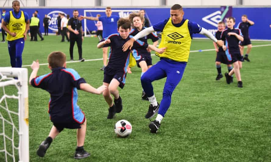 Richarlison takes on some youngsters during an Everton In The Community showcase event at Finch Farm in February.