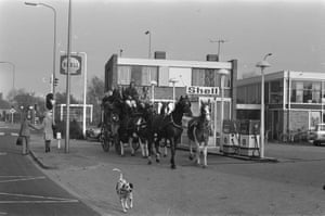 A stagecoach at a petrol station