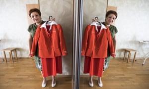 Evgenia Magurina holding her Aeroflot uniform