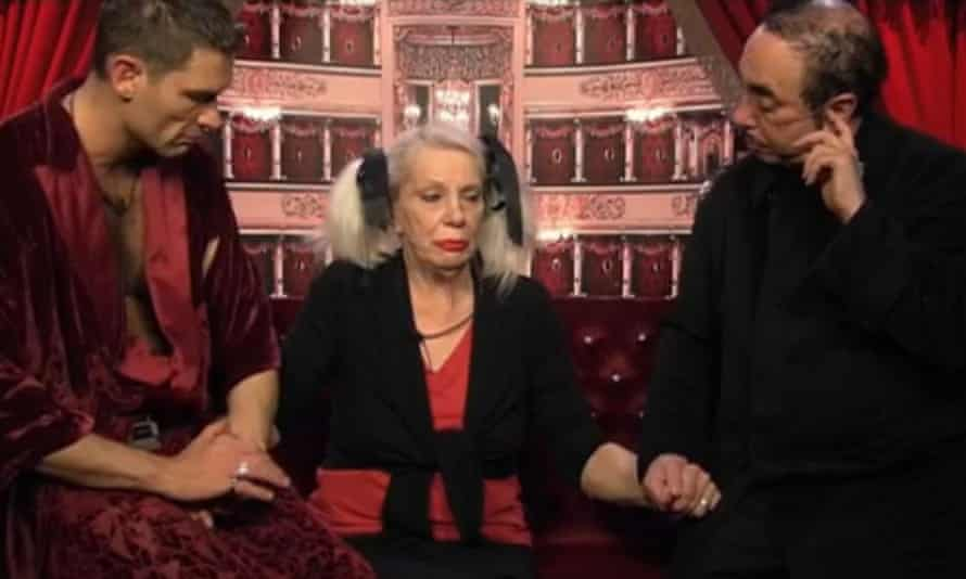 Angie Bowie is comforted by John Partridge and David Gest after being told her ex-husband David had died.