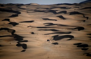Stage 2 Bisha to Wadi Ad-Dawasir Mini's Stephane Peterhansel and his co-driver Edouard Boulanger make their way across a dune ridden landscape