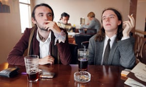 Two men drinking and smoking in a pub