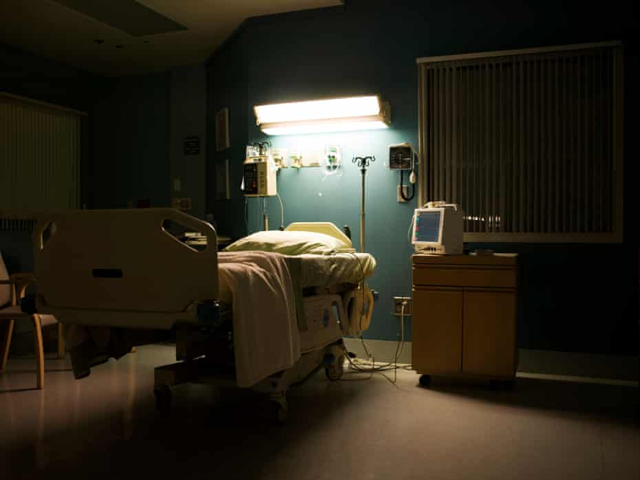 Bed in darkened empty hospital room USA, California, Hawthorne.