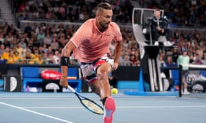 Nick Kyrgios of Australia returns a shot through his legs during his first-round match against Italy's Lorenzo Sonego at Melbourne Park.