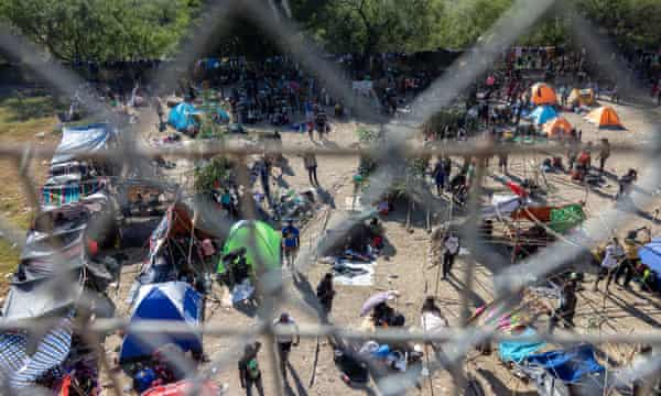Thousands of migrants, mostly from Haiti, gather at a makeshift encampment under the International Bridge between Del Rio, Texas and Acuña, Mexico.