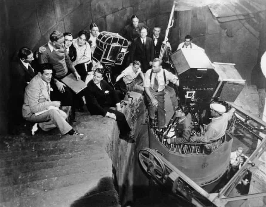 Class act … George Melford, third left with cast and crew, directed Valentino's The Sheik.