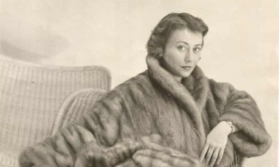 Marilyn Stafford in borrowed mink coat during a 1950s fashion shoot in Paris.