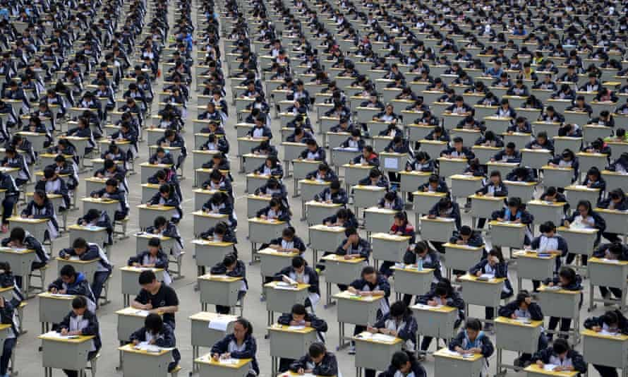 Students take an examination in a playground at a high school in Yichuan, Shaanxi province.