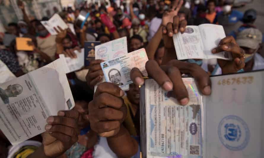 Haitians gather at the US embassy in hopes of visas amid fear and uncertainty following the assassination of the country's president.