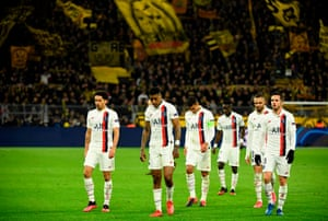 PSG's players leave the pitch after the match.