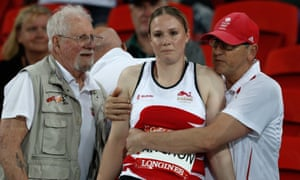 England's Sophie Hitchon is consoled after three no-throws put her out of the women's hammer competition.