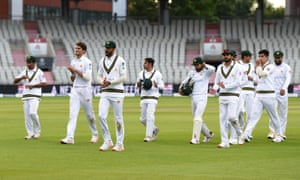 Shan Masood of Pakistan is applauded off by his teammates.