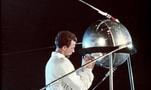 a soviet technician works on sputnik one in 1957
